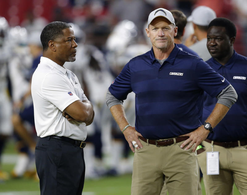 Arizona Cardinals head coach Steve Wilks, left, talks with Los Angeles Chargers assistant coach Ken Whisenhunt prior to an preseason NFL football game, Saturday, Aug. 11, 2018, in Glendale, Ariz. (AP Photo/Ross D. Franklin)