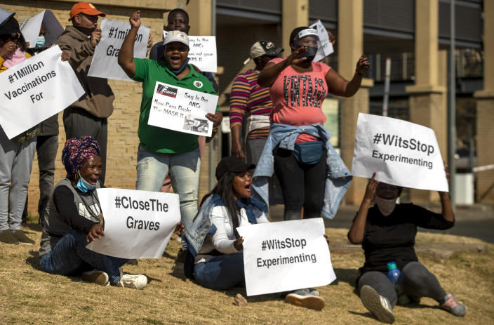 People protest against coronavirus trials in Africa, outside Chris Hani Baragwanath Hospita in the township of Soweto in Johannesburg, South Africa, Saturday, July 18, 2020, The first clinical trial in Africa for a COVID-19 vaccine started last week in South Africa. Experts note a worrying level of resistance and misinformation around testing on the continent. (AP Photo/Themba Hadebe)