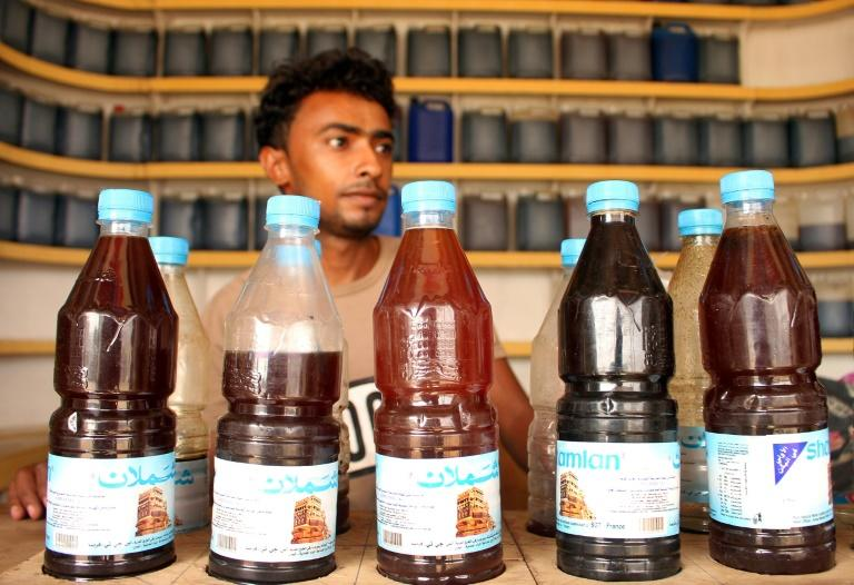 Yemeni beekeeper Ahmed Ali al-Adili with honey for sale in the Abs district of Hajjah province