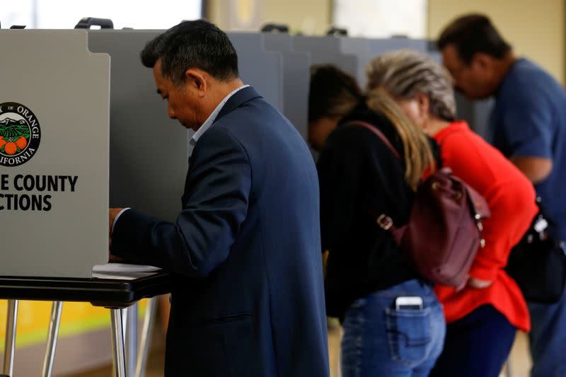 California voters cast their ballots in the March 3 Super Tuesday primary as new voting procedures and technology are used to make voting easier and more secure in Santa Ana, California