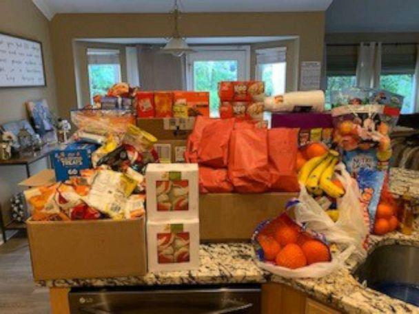 PHOTO: Food donated for the Hughes High School football team is pictured in Dana Gendreau's home in Cincinnati, Ohio. (Dana Gendreau)