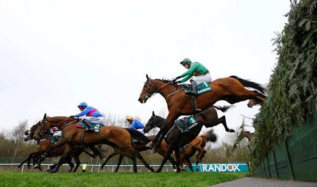 Horse Racing - Grand National Festival - Aintree Racecourse, Liverpool, Britain - April 12, 2018 Balnaslow ridden by Derek O'Connor (R) in action before winning the 16:05 Randox Health Foxhunters' Open Hunters' Chase REUTERS/Darren Staples