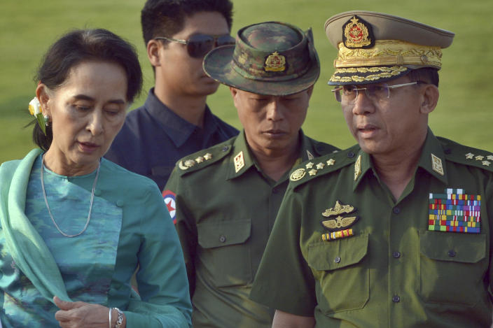FILE - In this May 6, 2016, file photo, Aung San Suu Kyi, left, Myanmar's foreign minister, walks with senior General Min Aung Hlaing, right, Myanmar military's commander-in-chief, in Naypyitaw, Myanmar. Myanmar military television said Monday, Feb. 1, 2021 that the military was taking control of the country for one year, while reports said many of the country's senior politicians including Suu Kyi had been detained. (AP Photo/Aung Shine Oo, File)