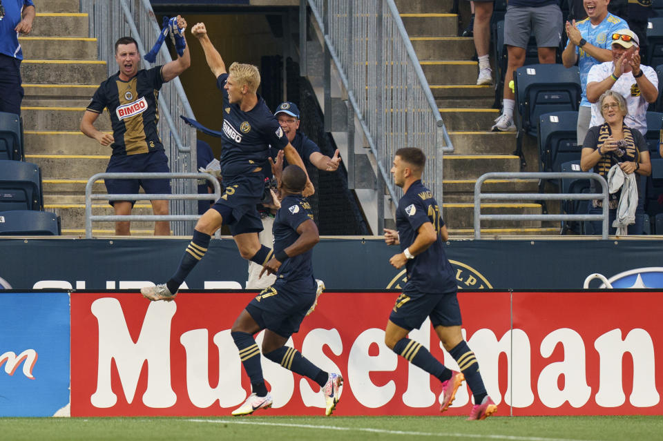 Philadelphia Union defender Jakob Glesnes, left, reacts to his goal during the first half of an MLS soccer match against the Toronto FC, Wednesday, Aug. 4, 2021, in Chester, Pa. (AP Photo/Christopher Szagola)