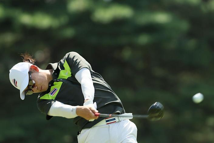 <p>Thailand's Jazz Janewattananond plays his shot from the 13th tee during the third round of the men's individual stroke play. </p>