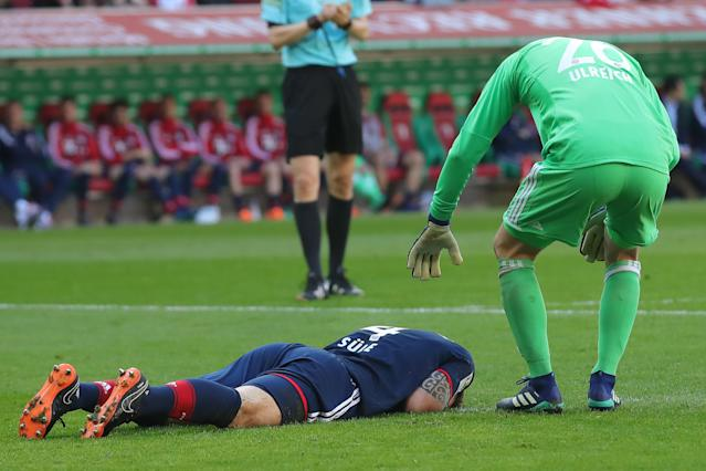 Bayern Munich defender Niklas Sule lies on the field after scoring his own goal. (Getty)