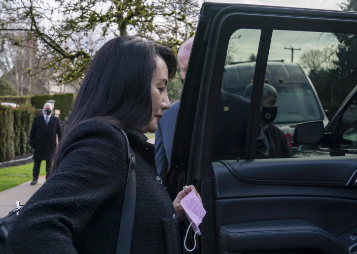 Chief Financial Officer of Huawei, Meng Wanzhou leaves her home in Vancouver, British Columbia, to go to British Columbia Supreme Court, Thursday, March 25, 2021. (Jonathan Hayward/The Canadian Press via AP)