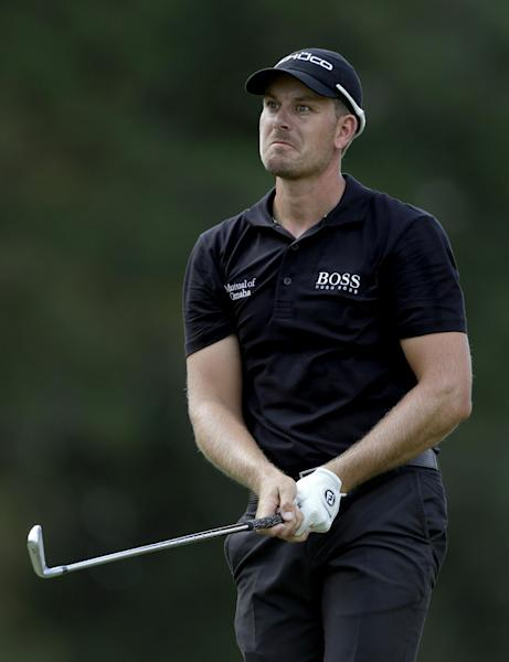 Henrik Stenson, of Sweden, watches his shot off the fifth fairway during the final round of play in the Tour Championship golf tournament at East Lake Golf Club in Atlanta, Sunday, Sept. 22, 2013. (AP Photo/John Bazemore)