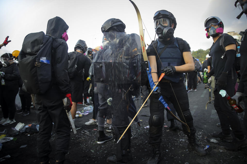 Students with their homemade gears take their position outside the Chinese University of Hong Kong, in Hong Kong, Wednesday, Nov. 13, 2019. Protesters in Hong Kong battled police on multiple fronts on Tuesday, from major disruptions during the morning rush hour to a late-night standoff at a prominent university, as the 5-month-old anti-government movement takes an increasingly violent turn. (AP Photo/Kin Cheung)