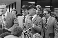 FILE - In this March 13, 1985 file photo, Tom Benson, left, and Louisiana Gov. Edwin Edwards smile as they announce that Benson just signed a deal purchasing the New Orleans Saints for $64 million at a press conference in New Orleans. Edwards, the high-living four-term governor whose three-decade dominance of Louisiana politics was all but overshadowed by scandal and an eight-year federal prison stretch, died Monday, July 12, 2021, of respiratory problems. He was 93. (AP Photo/Bill Haber, File)