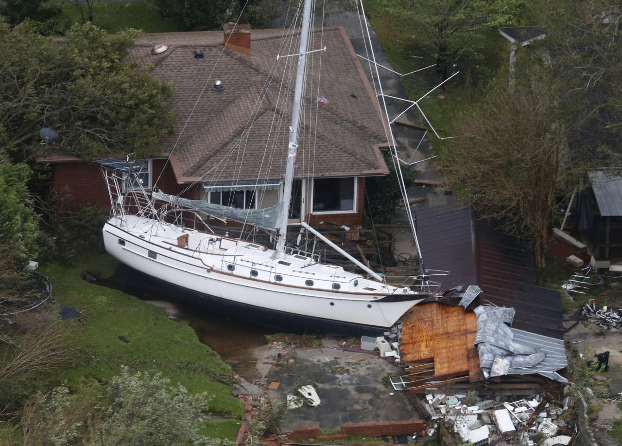 <p>This aerial photo shows a sailboat stacked up onto a house as a result from Florence, now a tropical storm, in New Bern, N.C., Saturday, Sept. 15, 2018. (Photo: Steve Helber/AP) </p>