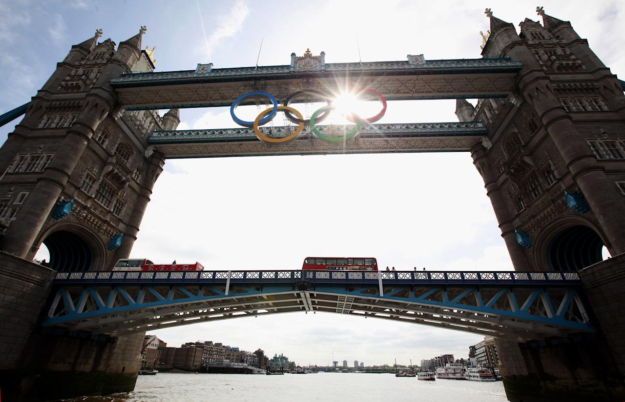 A giant set of Olympic rings are displayed from Tower Bridge on June 27, 2012 in London, England. The rings weigh over three tonnes and measure over 25 metres wide by 11.5 metres tall; they will be illuminated in a light-show every evening during the Games.  (Photo by Oli Scarff/Getty Images)