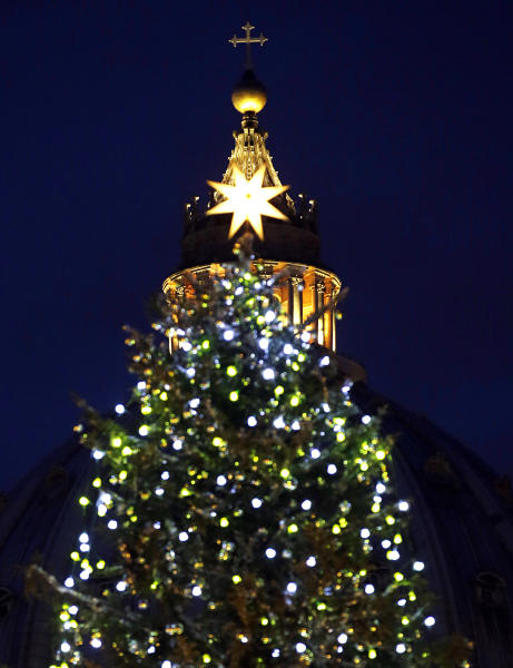 "The 24 meters (78.74 feet) Christmas tree is lit in St. Peter's square at the Vatican, Friday, Dec. 14, 2012. The Christmas season kicks off Friday at the Vatican with the traditional lighting of the tree in St. Peter's Square — and a reminder from the Pope about what happened when the ""lights"" of God were turned off in past atheistic regimes. (AP Photo/Gregorio Borgia)"