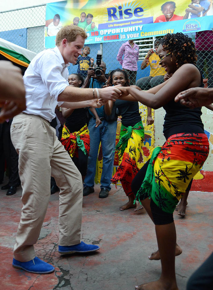 "Continuing his Caribbean tour, Prince Harry stopped in the island nation of Jamaica on Tuesday. During his visit to a youth community center he was asked for a dance by a local woman. Harry -- who donned some blue suede shoes -- boogied with his partner to the Bob Marley tune ""One Love."" (3/6/2012)"