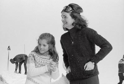 Jacqueline Kennedy Onassis cherishes a moment with daughter Caroline in Sun Valley, Idaho.