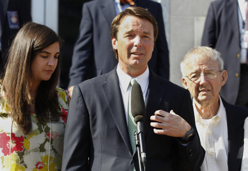 Ex-presidential candidate John Edwards speaks outside a federal courthouse as his daughter, Cate Edwards, left, and father Wallace Edwards, listen after his campaign finance fraud case ended in a mistrial Thursday, May 31, 2012 in Greensboro, N.C. Jurors acquitted Edwards on one charge and deadlocked on the other five, unable to decide whether he used money from two wealthy donors to hide his pregnant mistress while he ran for president and his wife was dying of cancer. (AP Photo/Chuck Burton)