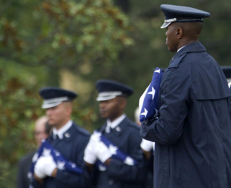 """Members of the Air Force Honor Guard hold American flags to be presented to family members during a burial service for Air Force Col. Joseph Christiano, Col. Derrell B. Jeffords, Lt. Col. Dennis L. Eilers, Chieft Master Sgt. William K. Colwell, Chief Master Sgt. Arden K. Hassenger and Chief Master Sgt. Larry C. Thornton, Monday, July 9, 2012, at Arlington National Cemetery Arlington, Va. It was Christmas Eve 1965 when the Air Force plane nicknamed """"Spooky"""" took off from Vietnam for a combat mission. The crew sent out a """"mayday"""" signal while flying over Laos, and after that, all contact was lost. Two days of searches turned up nothing. (AP Photo/Haraz N. Ghanbari)"""