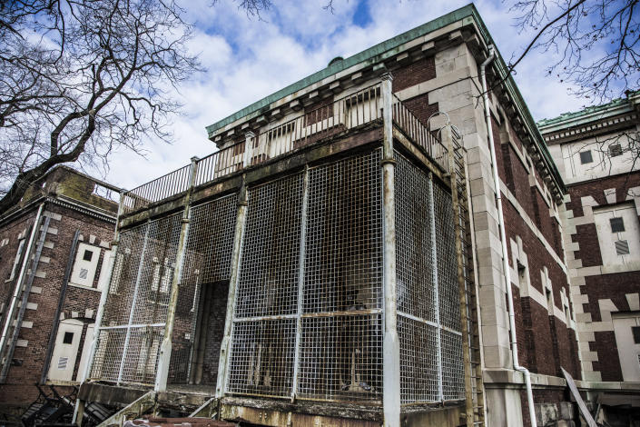 <p>A fenced-in hospital building that was used to house psychiatric patients on Ellis Island. (Photo: Gordon Donovan/Yahoo News) </p>