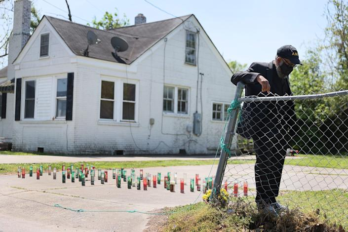 Jay McNar prays in front of the spot where Andrew Brown Jr. was killed by Pasquotank County Sheriff's deputies on April 28, 2021 in Elizabeth City, N.C. A North Carolina judge ruled that video from four body cameras showing the shooting death of Andrew Brown Jr. will not be released publicly at this time. Andrew Brown Jr. was killed on April 21 by Pasquotank County Sheriff's deputies.