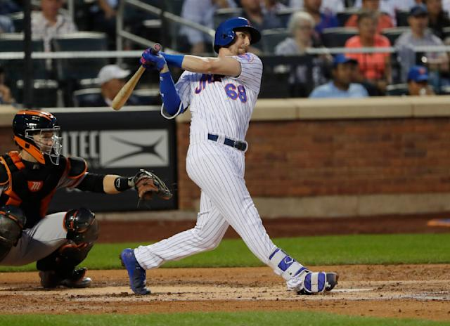 New York Mets' Jeff McNeil follows through on an RBI single during the second inning against the San Francisco Giants in a baseball game Wednesday, Aug. 22, 2018, in New York. (AP Photo/Frank Franklin II)