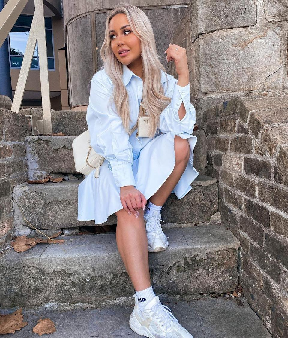 MAFS' Cathy Evans sits on steps