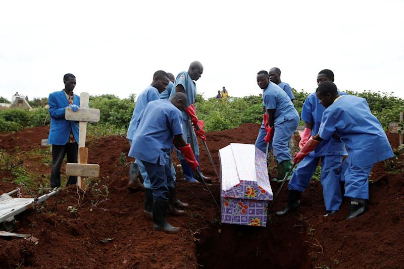 Congolese Red Cross workers carry the coffin of a Congolese woman, Kahambu Tulirwaho, who died of Ebola, during a burial service at a cemetery in Butembo, the Democratic Republic of Congo, March 28, 2019. (Photo: Baz Ratner/Reuters)