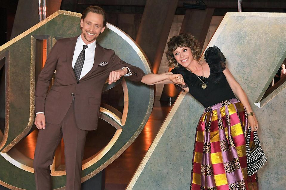 <p>Tom Hiddleston and Sophia Di Martino bump elbows at a special preview screening of Marvel Studio's <em>Loki</em>, presented by Disney+, on June 8 in London.</p>