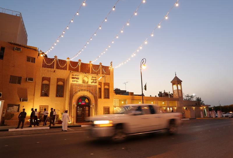A car passes in front of the main entrance of Al Koot Heritage Hotel in Al Ahsa