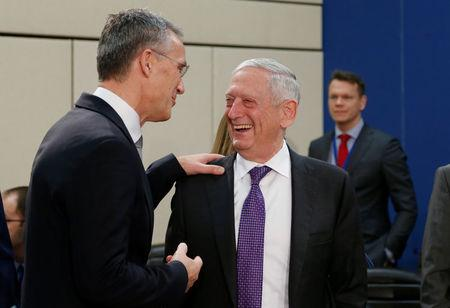 NATO Secretary-General Jens Stoltenberg and U.S. Secretary of Defence Jim Mattis attend a NATO defence ministers meeting at the Alliance headquarters in Brussels, Belgium, February 15, 2018. REUTERS/Francois Lenoir