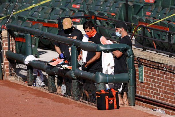 PHOTO: Staff members of the Baltimore Orioles clubhouse clean players shoes in the photo well before the start of the Orioles and New York Yankees game at Oriole Park at Camden Yards on July 29, 2020 in Baltimore. (Rob Carr/Getty Images)