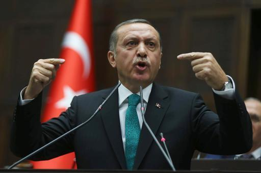 Turkey's Prime Minister Recep Tayyip Erdogan delivers a speech to parliament in Ankara on January 14, 2014