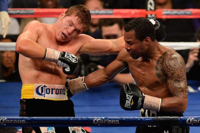 LAS VEGAS, NV - MAY 05: (R-L) Shane Mosley throws a right at Canelo Alvarez during their WBC super welterweight title fight at the MGM Grand Garden Arena on May 5, 2012 in Las Vegas, Nevada. (Photo by Ethan Miller/Getty Images)
