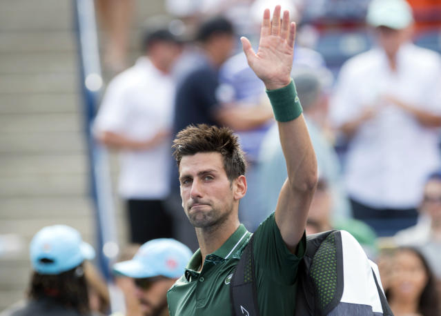 Novak Djokovic, of Serbia, waves to the crowd after loss to Stefanos Tsitsipas, of Greece, during the Rogers Cup men's tennis tournament in Toronto, Thursday, Aug. 9, 2018. (Frank Gunn/The Canadian Press via AP)