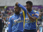 Sri Lanka's Charith Asalanka, left, and Ishan Jayaratne wait before entering the field for England innings on the third one day international cricket match between England and Sri Lanka, at Bristol County Ground in Bristol, England, Sunday, July 4, 2021. (AP Photo/Rui Vieira)