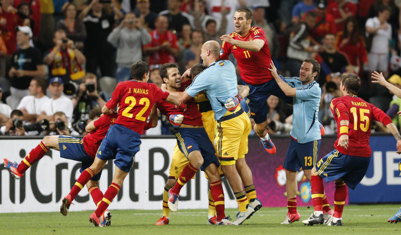 Spanish players celebrate after Cesc Fabregas, center, scored the decisive goal in the penalty shootout of the Euro 2012 soccer championship semifinal match between Spain and Portugal in Donetsk, Ukraine, Thursday, June 28, 2012. (AP Photo/Antonio Calanni)