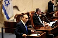 Naftali Bennett, Prime Minister-designate, speaks at the Knesset, Israel's parliament, during a special session whereby a confidence vote will be held to approve and swear-in a new coalition government, in Jerusalem