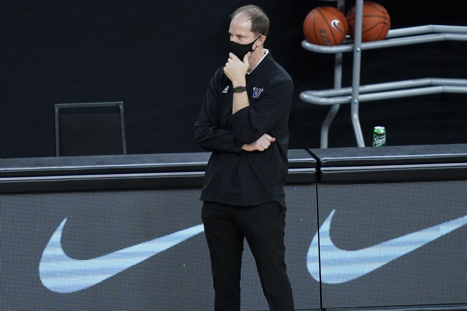 Washington's head coach Mike Hopkins watches during the second half of an NCAA college basketball game against Baylor, Sunday, Nov. 29, 2020, in Las Vegas. (AP Photo/John Locher)