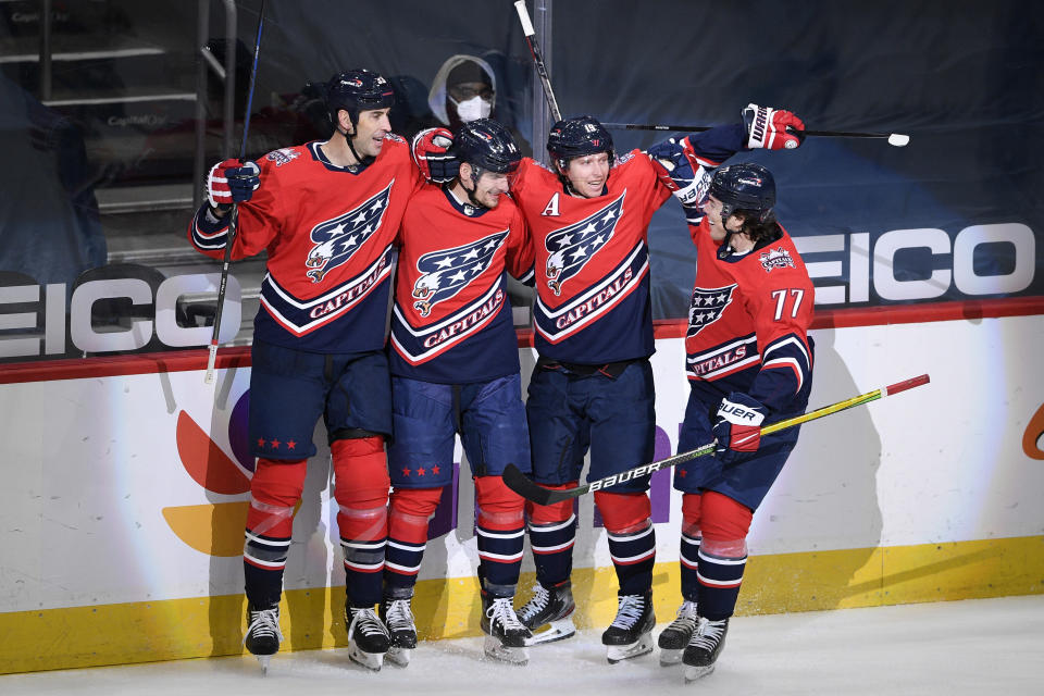 Washington Capitals right wing Richard Panik, second from the left, celebrates his goal with defenseman Zdeno Chara (33), center Nicklas Backstrom (19) and right wing T.J. Oshie (77) during the second period of an NHL hockey game against the Pittsburgh Penguins, Tuesday, Feb. 23, 2021, in Washington. (AP Photo/Nick Wass)