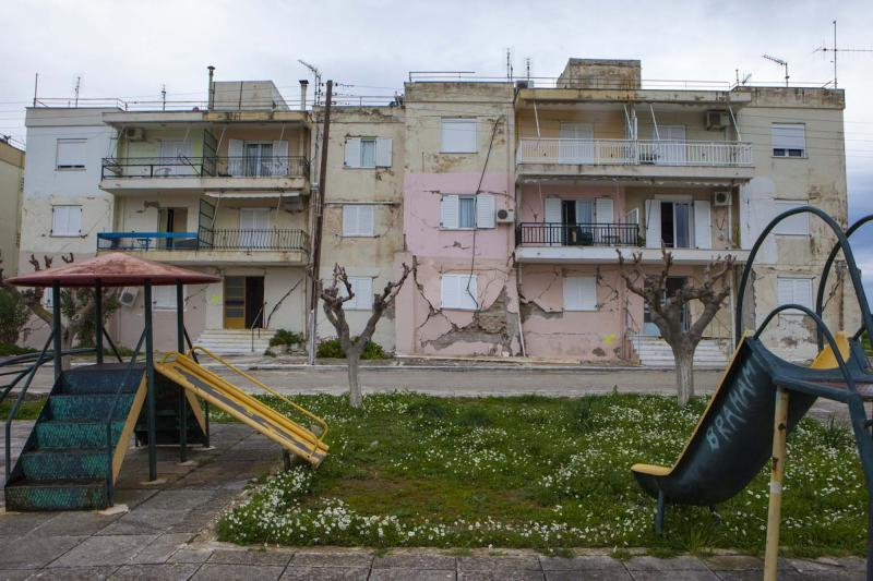 Damaged buildings are seen next to a playground after an earthquake in Lixouri on the island of Kefalonia, western Greece on Monday, Feb. 3, 2014. A strong earthquake with a preliminary magnitude between 5.7 and 6.1 hit the western Greek island of Kefalonia before dawn Monday, sending scared residents into the streets just over a week after a similar quake damaged hundreds of buildings, reviving memories of a disaster in the 1950s. (AP Photo)