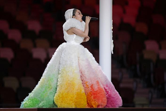 """<p>Japanese singer Misia sings Japan's national anthem """"Kimi Ga Yo"""" during the opening ceremony of the Tokyo 2020 Olympic Games, at the Olympic Stadium in Tokyo, on July 23, 2021. (Photo by HANNAH MCKAY / POOL / AFP) (Photo by HANNAH MCKAY/POOL/AFP via Getty Images)</p>"""