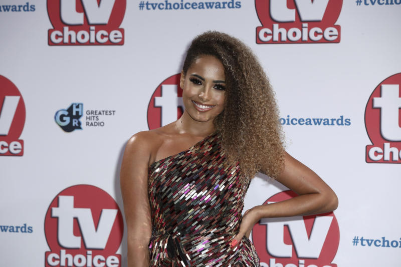 Reality Tv personality Amber Gill poses for photographers on arrival at the TV Choice Awards in central London on Monday, Sept. 9, 2019. (Photo by Grant Pollard/Invision/AP)