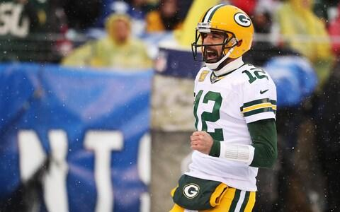 Aaron Rodgers #12 of the Green Bay Packers celebrates a touchdown throw to Allen Lazard #13 against the New York Giants during their game at MetLife Stadium on December 01, 2019 in East Rutherford, New Jersey - Credit: Getty Images