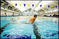 """<p>Prior to the Beijing Olympics, Phelps followed his longtime coach, Bob Bowman, to the <a href=""""https://www.mlive.com/wolverines/2016/09/michael_phelps_says_son_will_b.html#:~:text=The%2023%2Dtime%20Olympic%20gold,apparently%20impact%20his%20first%20born."""" rel=""""nofollow noopener"""" target=""""_blank"""" data-ylk=""""slk:University of Michigan"""" class=""""link rapid-noclick-resp"""">University of Michigan</a>. The swimmer competed for Club Wolverine and took classes at the prestigious university before heading to his third Summer Games. </p>"""
