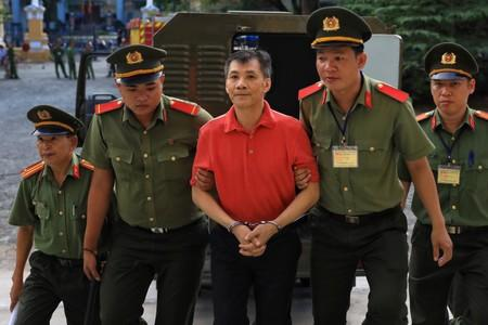 Vietnam jails American for 12 years on charge of attempting to overthrow state