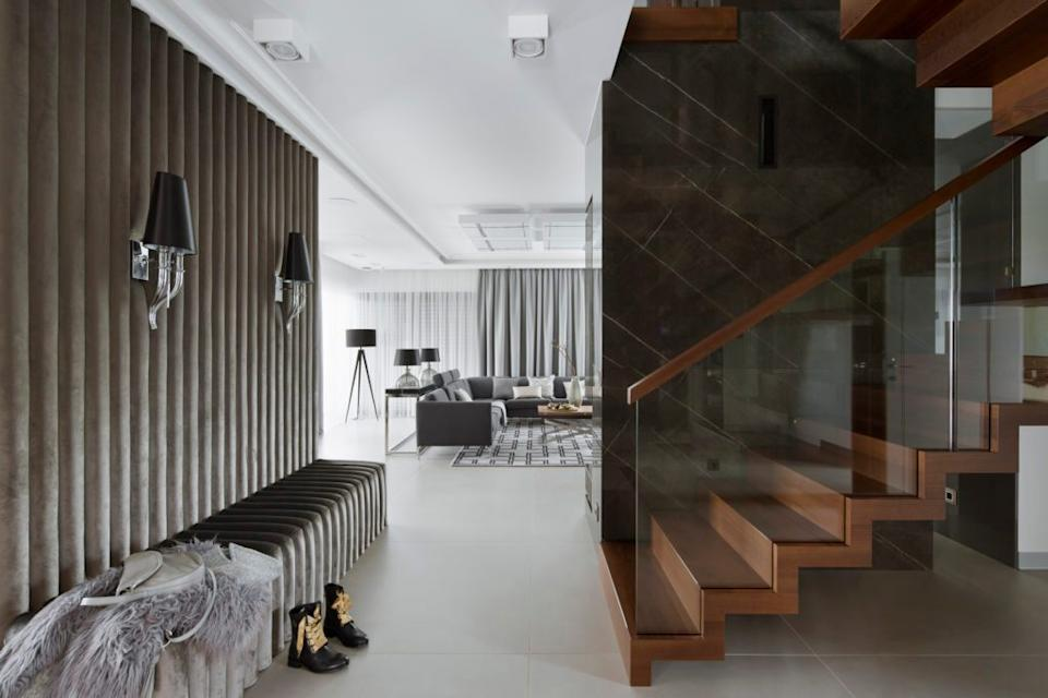These HOLA-designed interiors in a Northern Poland home are ultramodern with a couple cozy twists.