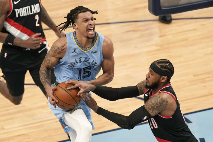 Memphis Grizzlies' Brandon Clarke (15) drives against Portland Trail Blazers' Carmelo Anthony (00) in the first half of an NBA basketball game Wednesday, April 28, 2021, in Memphis, Tenn. (AP Photo/Mark Humphrey)