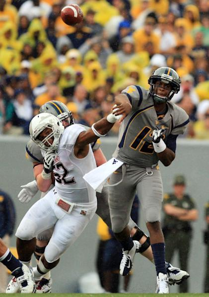 West Virginia quaterback Geno Smith (12) gets a pass off as he is pressured by Maryland's Darin Drakeford (52) during their NCAA college football game in Morgantown, W.Va., Saturday, Sept. 22, 2012. (AP Photo/Christopher Jackson)