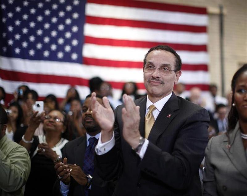 Washington Mayor Gray applauds U.S. President Barack Obama at a school in Washington