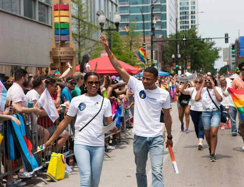 Emmons waves beside his wife, Brittani, at the 2019 Chicago Pride Parade on June 30. (Photo: Eli Jenkinson, Friends to Elect Robert Emmons Jr.)