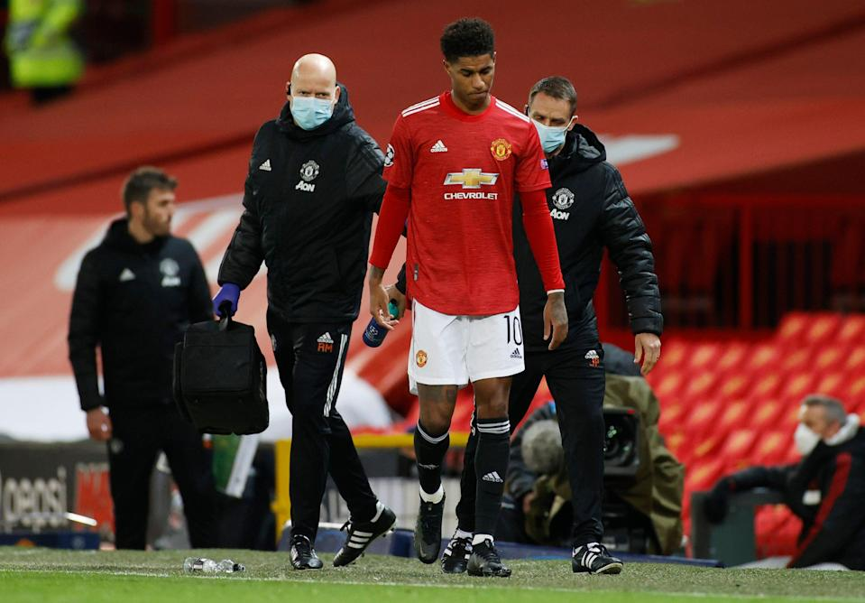 Marcus Rashford leaves the pitch with an injury (Reuters)